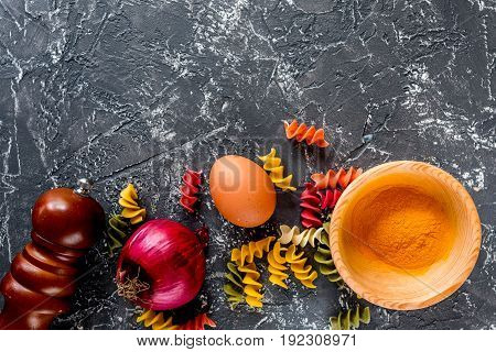 Italian food concept pasta ingredients on grey stone desk background top view copyspace.