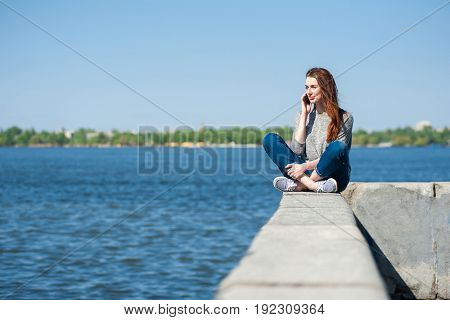 Girl Is Sitting On A Parapet 01