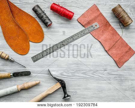 Work desk of clobber. Skin and tools on grey wooden desk background top view copyspace.
