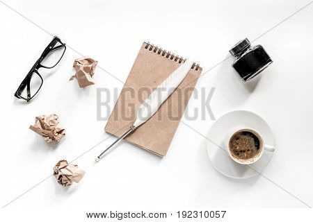 Writer concept. Feather pen, vintage notebook and crumpled paper on white background top view.