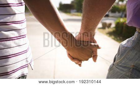 Men Holding Hands Gay Couple Walking On Street