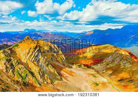 Clouds cover the mountain tops at autumn evening time. Caucasus. Russia.