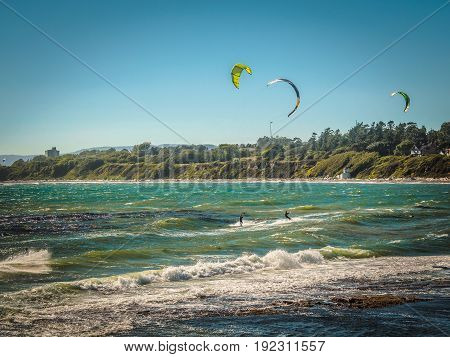 Kite surfers in action on a windy day