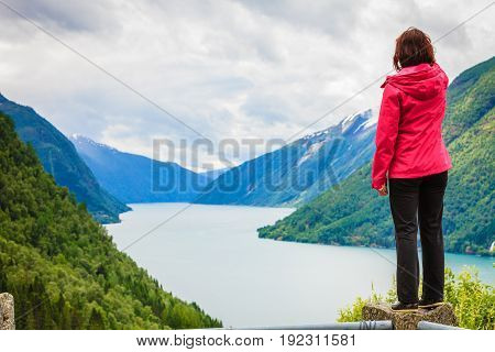 Woman Tourist In Norwegian Mountains Fjords