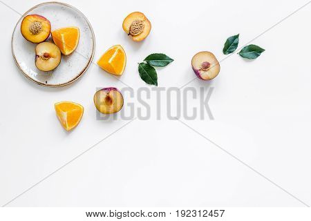 woman summer breackfast with orange and peach fruits on plates on white desk background flat lay mockup