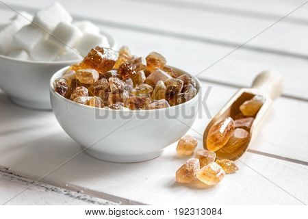 white and brown sugar for cooking sweets on kitchen white wooden table background top view close up