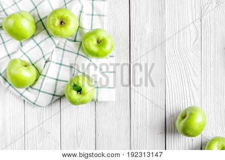 ripe green apples on white table background top view space for text
