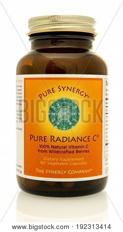 Winneconne WI - 4 June 2017: A bottle of Pure Synergy radiance vitamin C capsules an isolated background