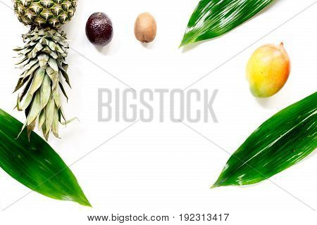 Exotic fruits mangosteen, mango, kiwi and lime on white background top view.