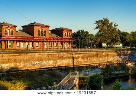 KENT OH - SEPTEMBER 4 2016: The old train depot overlooks the Cuyahoga River and the riverwalk a popular trail with one of its viewing platforms above the river.