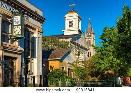 GRANVILLE OH - MAY 15 2017: A bank two churches and a small historical museum fill the south side of Broadway Avenue in this charming east-central Ohio village.