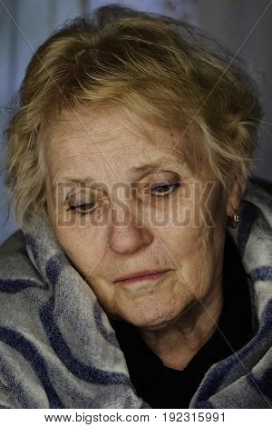 portrait of an elderly woman thinking about something