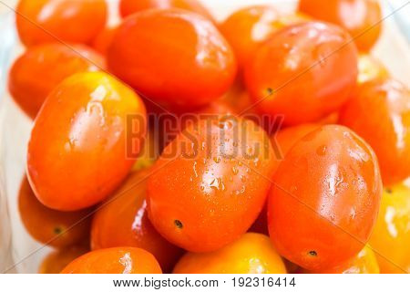 Fresh tomatoes in glass box on the table