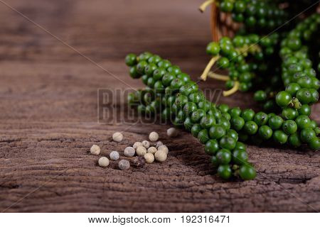 fresh and dried peppercorn on wooden table