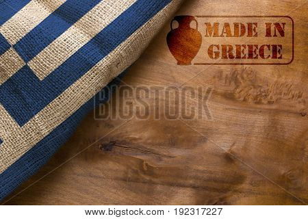 Stamp Made in Greece poster with the national flag of Greece.