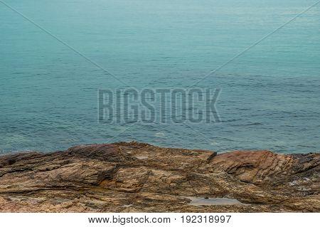 Rocks on the beach and blue sea