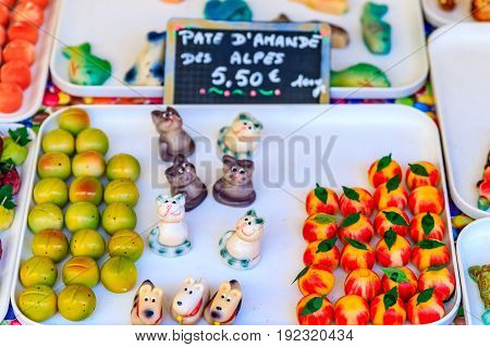 Colorful marzipan or almond paste candy made to look like fruits and vegetables and a market in Nice France.