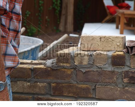 The level line guides the brick mason to keep his rows in line, and straight.