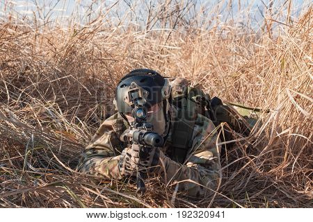 Airsoft soldiers in uniform on the battlefield outdoor
