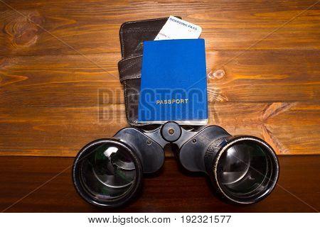 Travel planning and concept- passport, boarding pass and binoculars