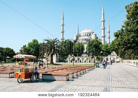 Istanbul, June 16, 2017: The famous Blue Mosque in Istanbul is also called Sultanahmet. Turkey. The seller on the square sells a traditional Turkish snack called Simit.