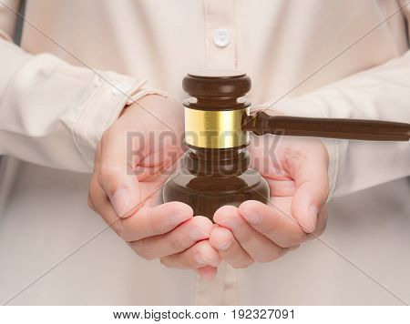 hand holding 3d rendering gavel judge for law concept