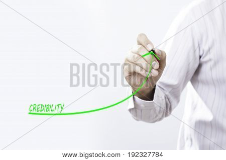 Businessman draw growing graph symbolize growing credibility