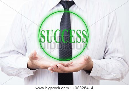 Success business concept. Businessman hold virtual label with text success.