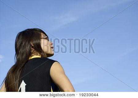 Asian girl look up with blue sky