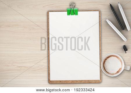 blank clipboard on office desk top view