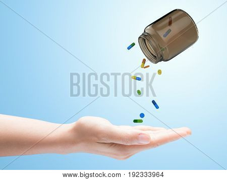 3d rendering pills spilling out of bottle on blue background