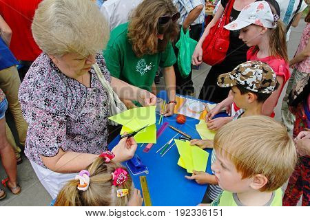 Volgograd Russia - June 12 2014: Master class for making a kite at the kite festival in Volgograd