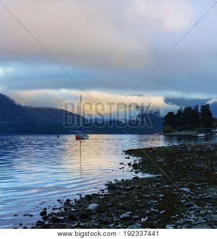 Beautiful Lake Te Anau is the second-largest lake in New Zealand with fog in the morning South Island of New Zealand