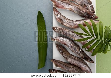 Raw Fresh-frozen Capelin Close-up On A Light Blue-green Background..