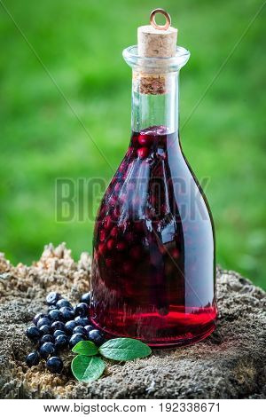 Tasty Liqueur In A Bottle Made Of Alcohol And Blueberries
