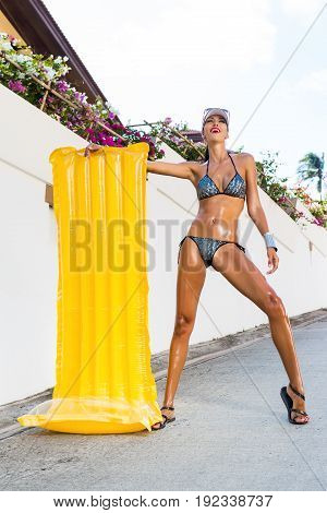 Sexy Lady With Long Legs Near White Wall.