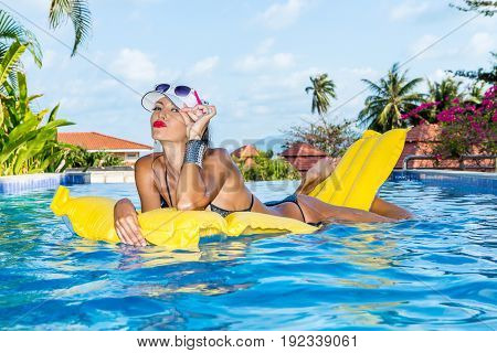 Sexy Lady With Long Legs At The Pool.