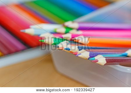 Color Pencils In A Transparent Plastic Storage Box