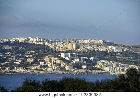 Panoramic view of Melieha, Malta in early sunrise light. Sunrise in Melieha, Malta, Europe