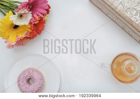 Pink Donut, Cup Of Tea, Flowers On A White Background