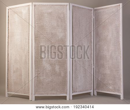 Old White Folding Wooden Screen Isolated On A Gray Background