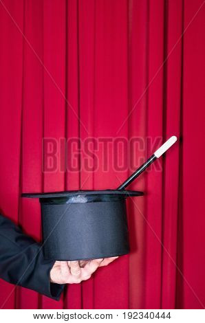 Magic Hat In Magician Hands, Color Image, Red Background