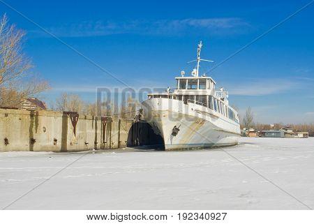 Retired pleasure boat on a winter berthing.