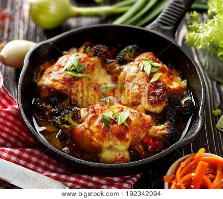 Roasted chicken thighs  stuffed with vegetables, baked with mozzarella cheese on a iron pan