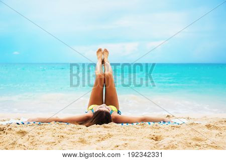Young Suntan Woman Lying Stretching Up Slender Leg