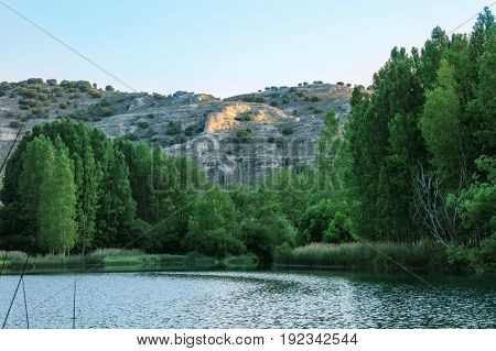 A photo of Laguna de Somolinos, a mountain lagoon in Guadalajara, Spain, in the morning