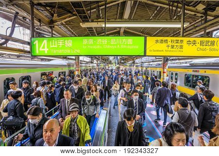 Tokyo, Japan - April 17, 2017: croud of commuters and businessmen at rush hour in Shinjuku Station, the Tokyo's main station at JR Line platforms: Yamanote Loop Line and Sobu Line.