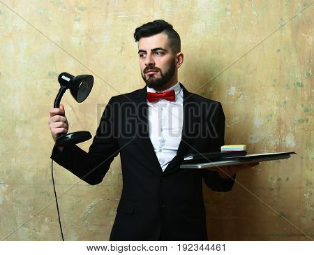 Office Manager With Neat Beard, Hairstyle, Interested Face Holding Lamp