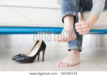 woman athlete's foot close up with health concept
