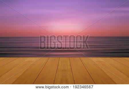 wood floor on sea with purple sunset Burning Skie beautiful natural tropical sea